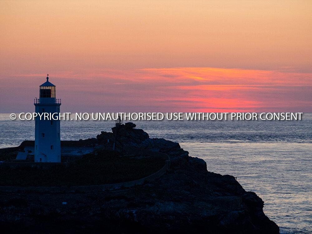 SUNSET AT GODREVY LIGHTHOUSE by Rory Morrison.jpg