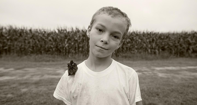 The boy and his bird, near Accomack, Virginia