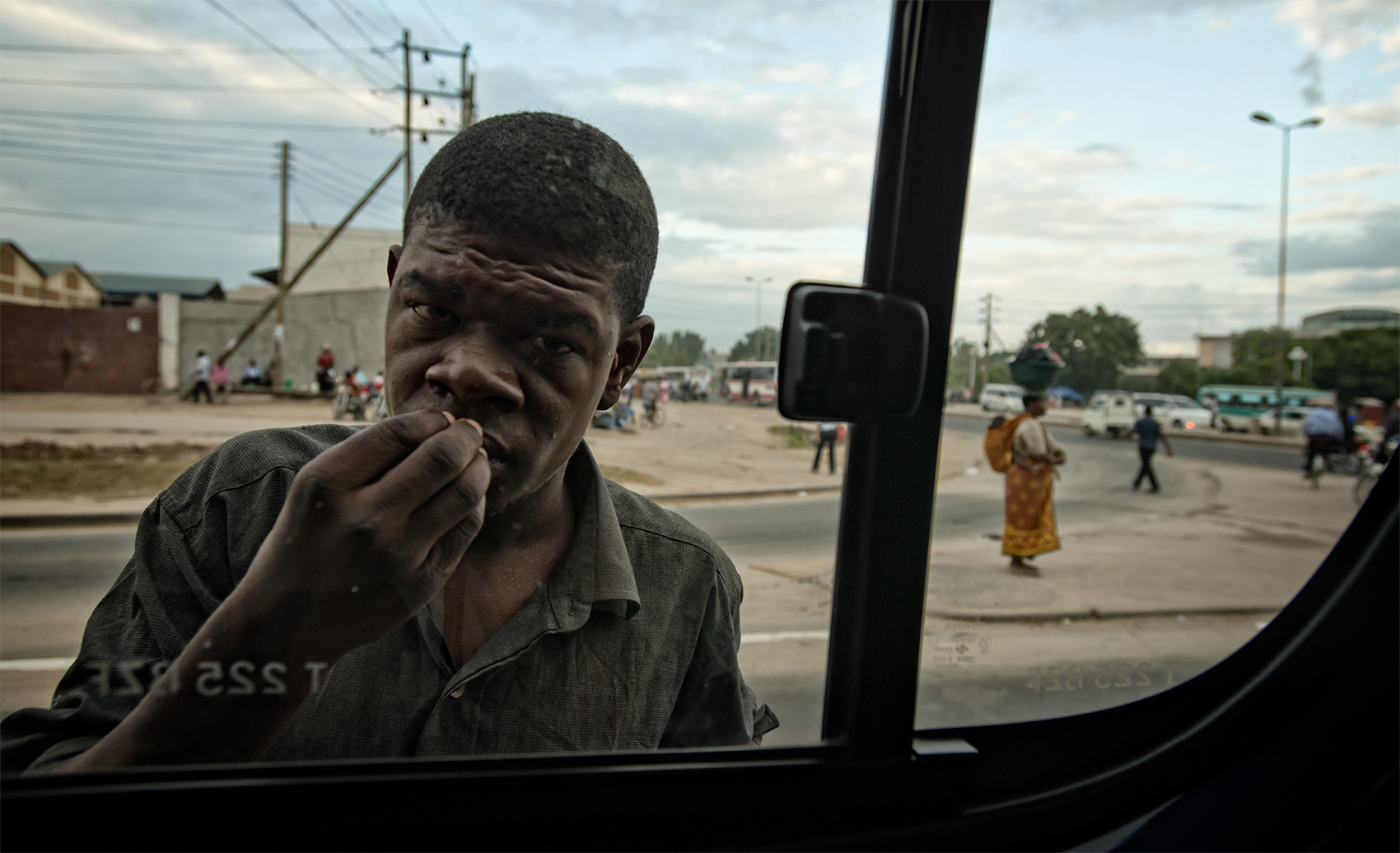 Hungry at the window, Dar Es Salaam, Tanzania
