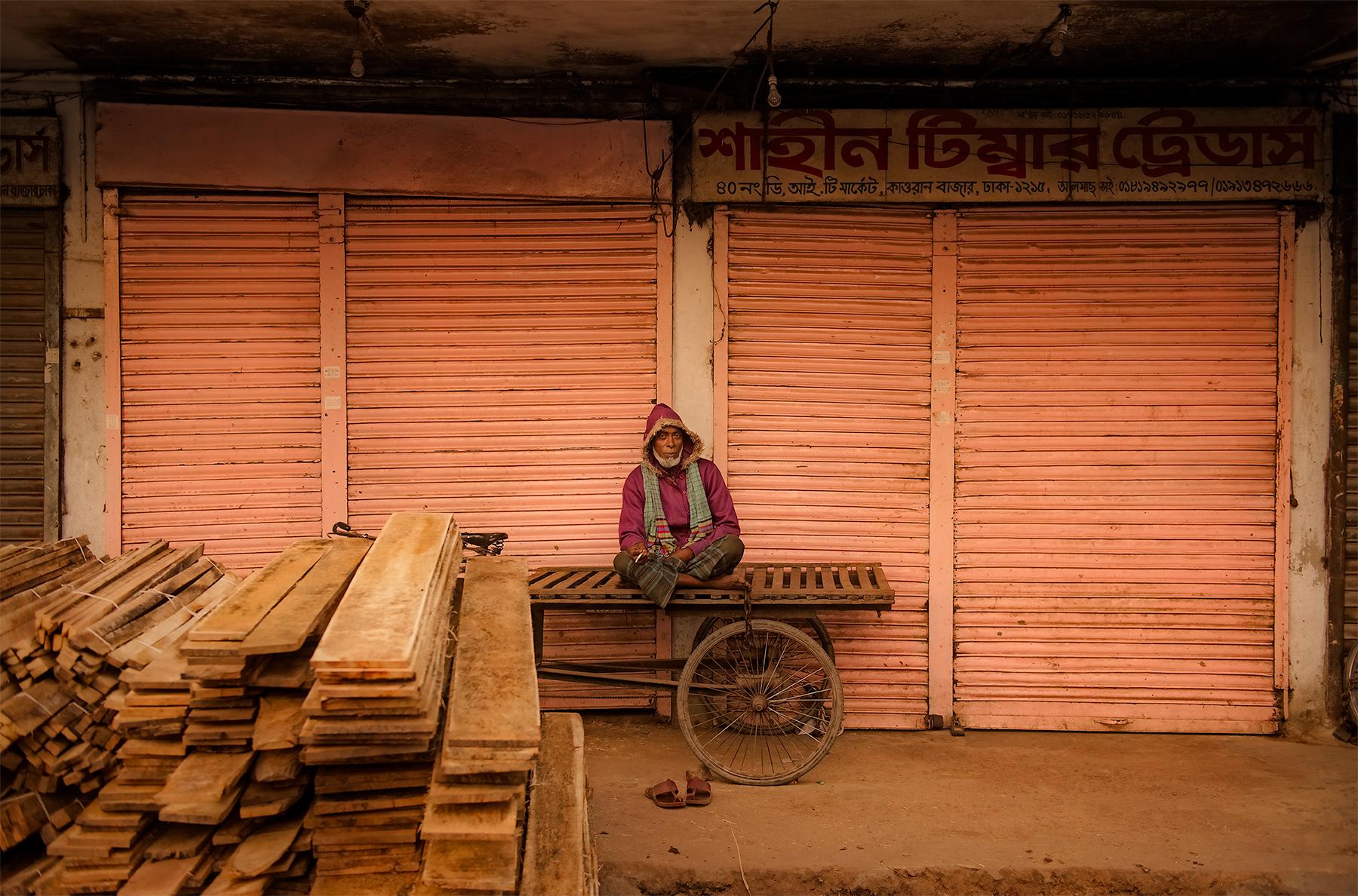 Man at the market, Dhaka, Bangladesh