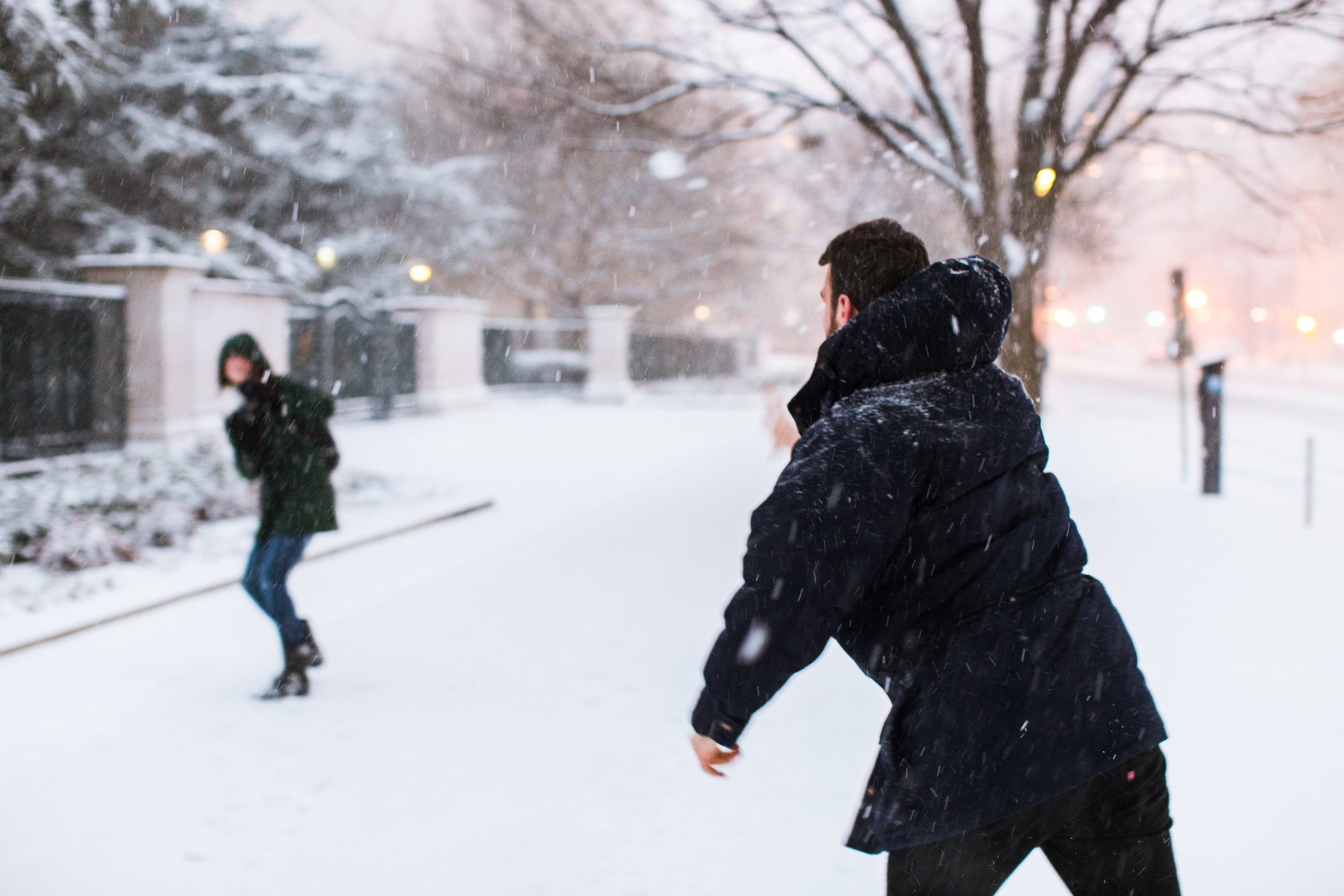 These lovely people moved here from California. This was their first blizzard but judging from his throwing technique, not their first snowball fight.