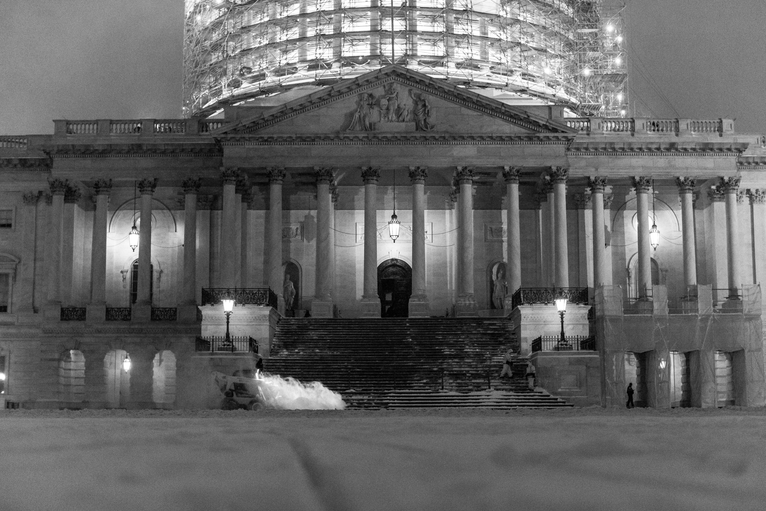 Crews worked constantly to keep snow cleared on the Capitol steps.