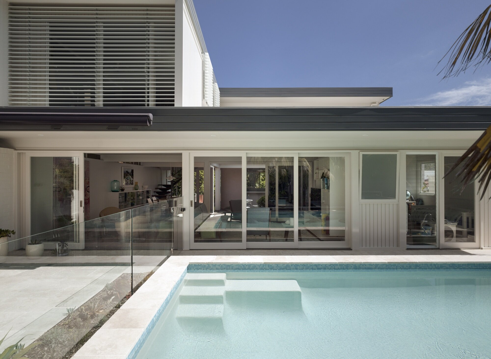 Pool Courtyard. The pool was reconfigured creating more sun drenched terrace space for entertaining and landscaping