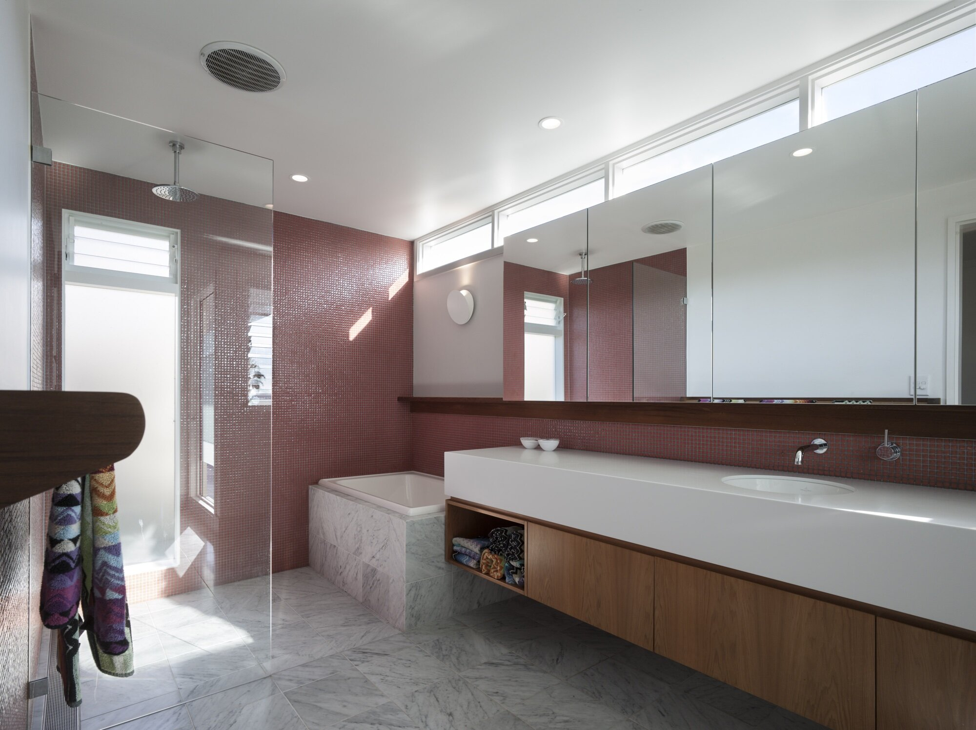 Pink tones are reflected throughout the house linking the spaces