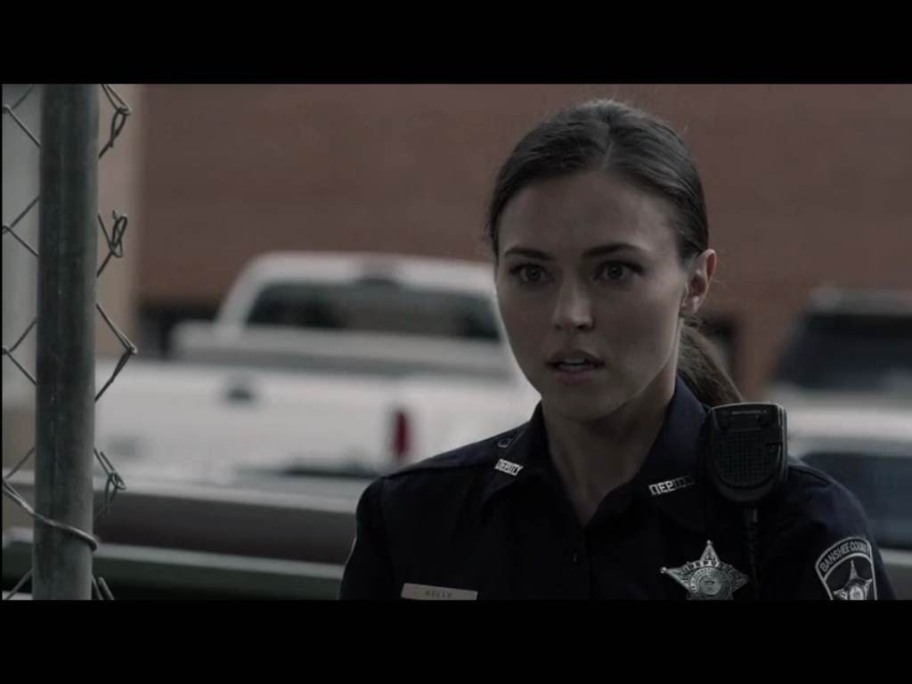 Beautiful deputy ... everyone's beautiful in this of course, but I see a lot of Injun in her (and like what I see)