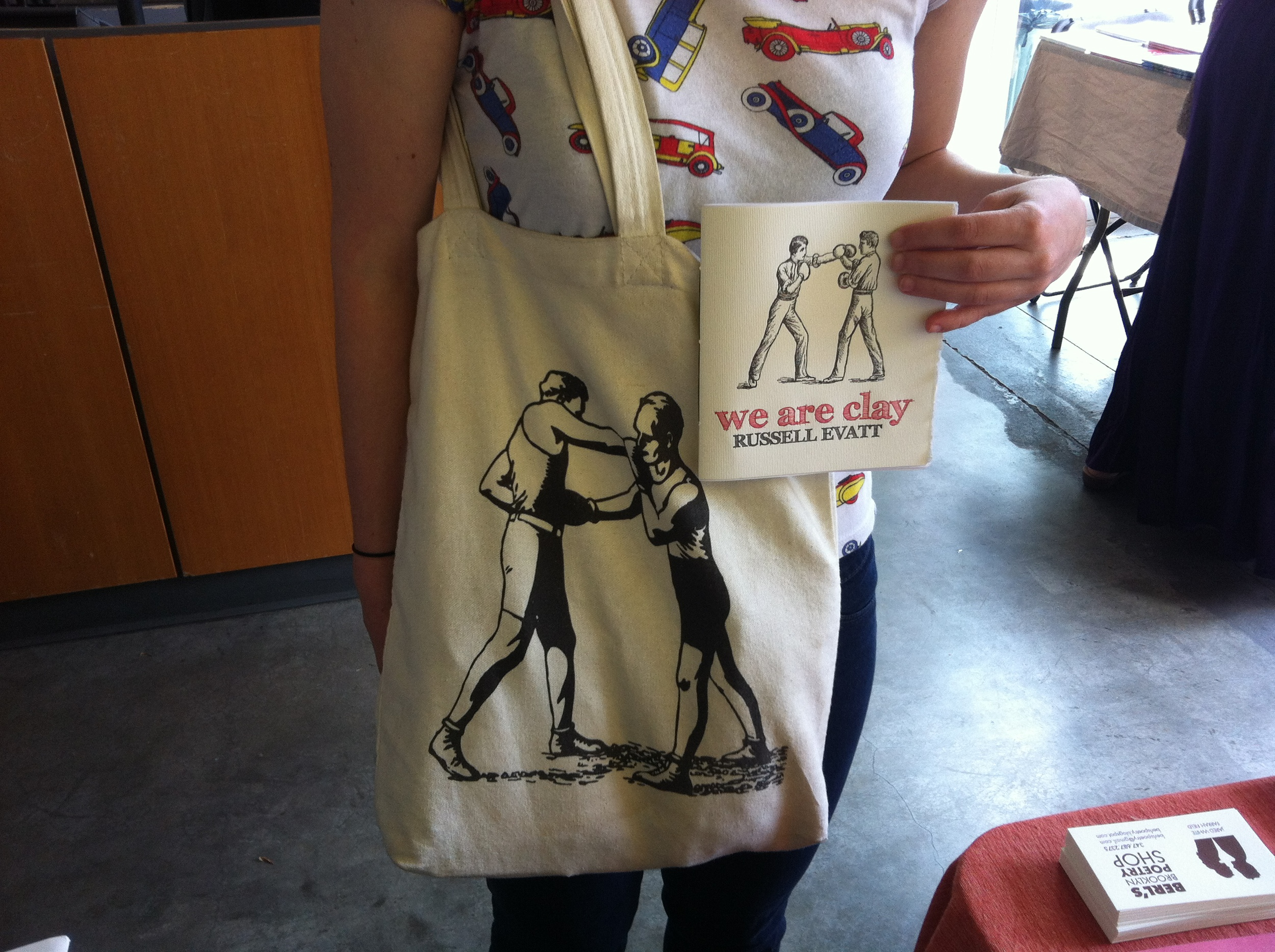 A tote at the Brooklyn Flea with an uncanny resemblance to WE ARE CLAY by Russell Evatt (Epiphany Editions