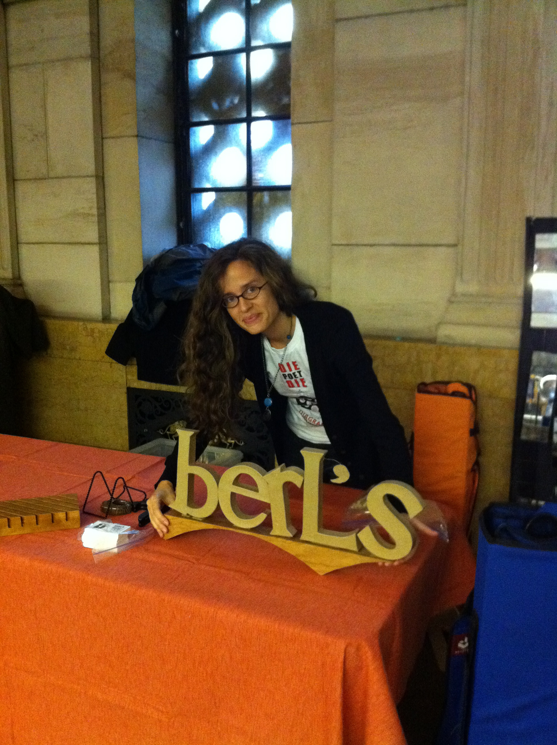 Day One! Farrah brandishes our first Berl's sign, designed by Jared's father.