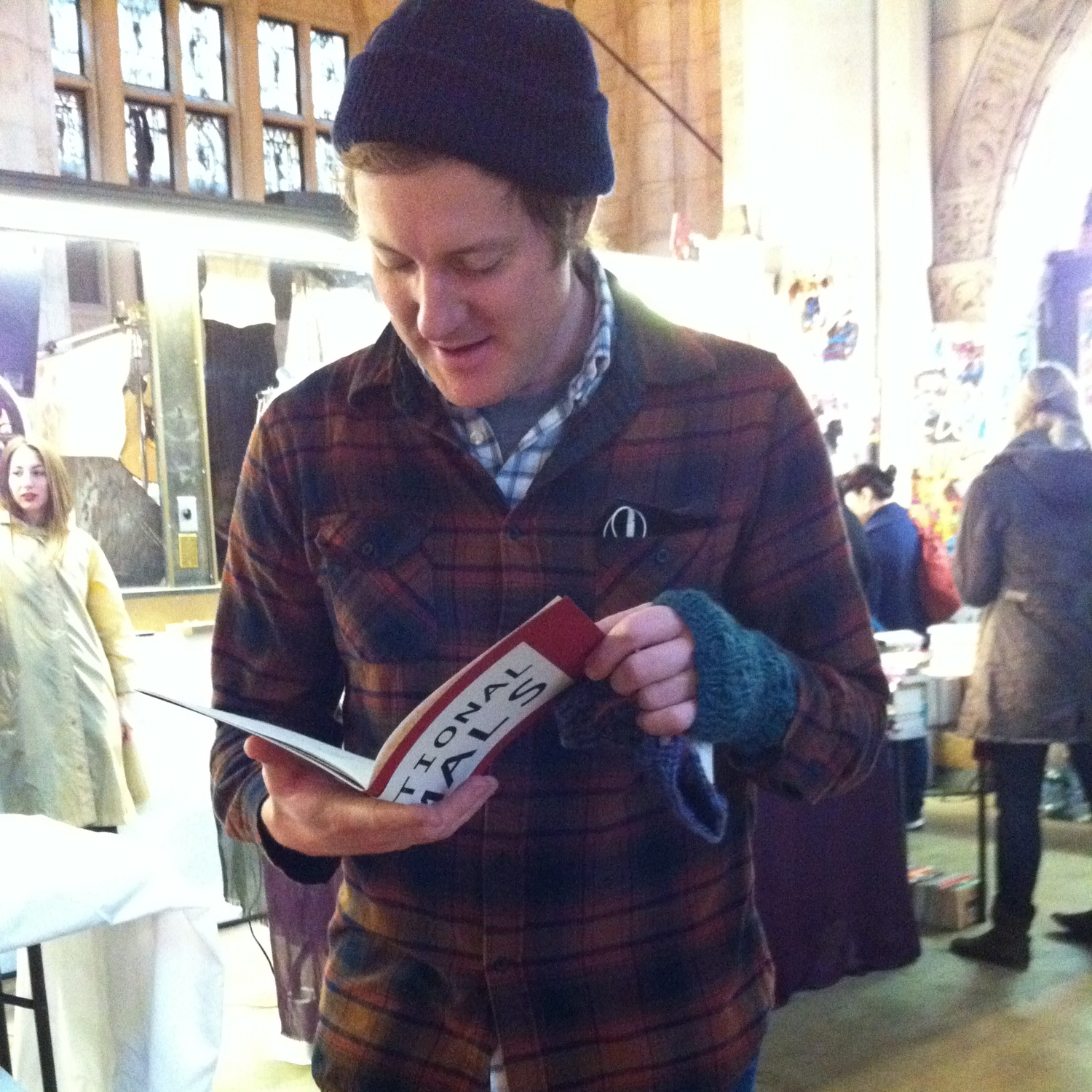 Our very first customer was poet Zachary Schomburg, here perusing (IR)RATIONAL ANIMALS by Steven Karl from Flying Guillotine Press.