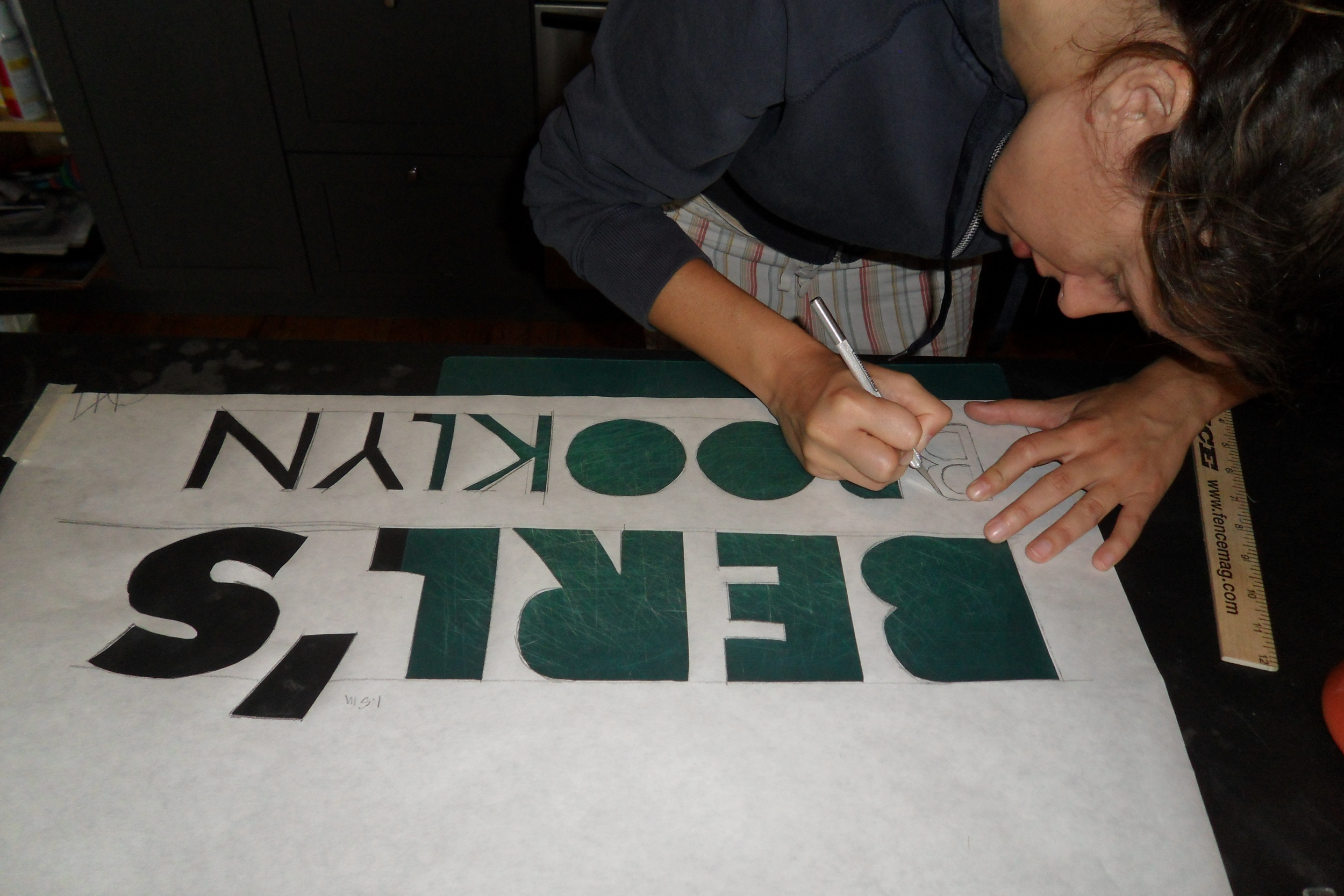 Farrah cutting a stencil for our banner