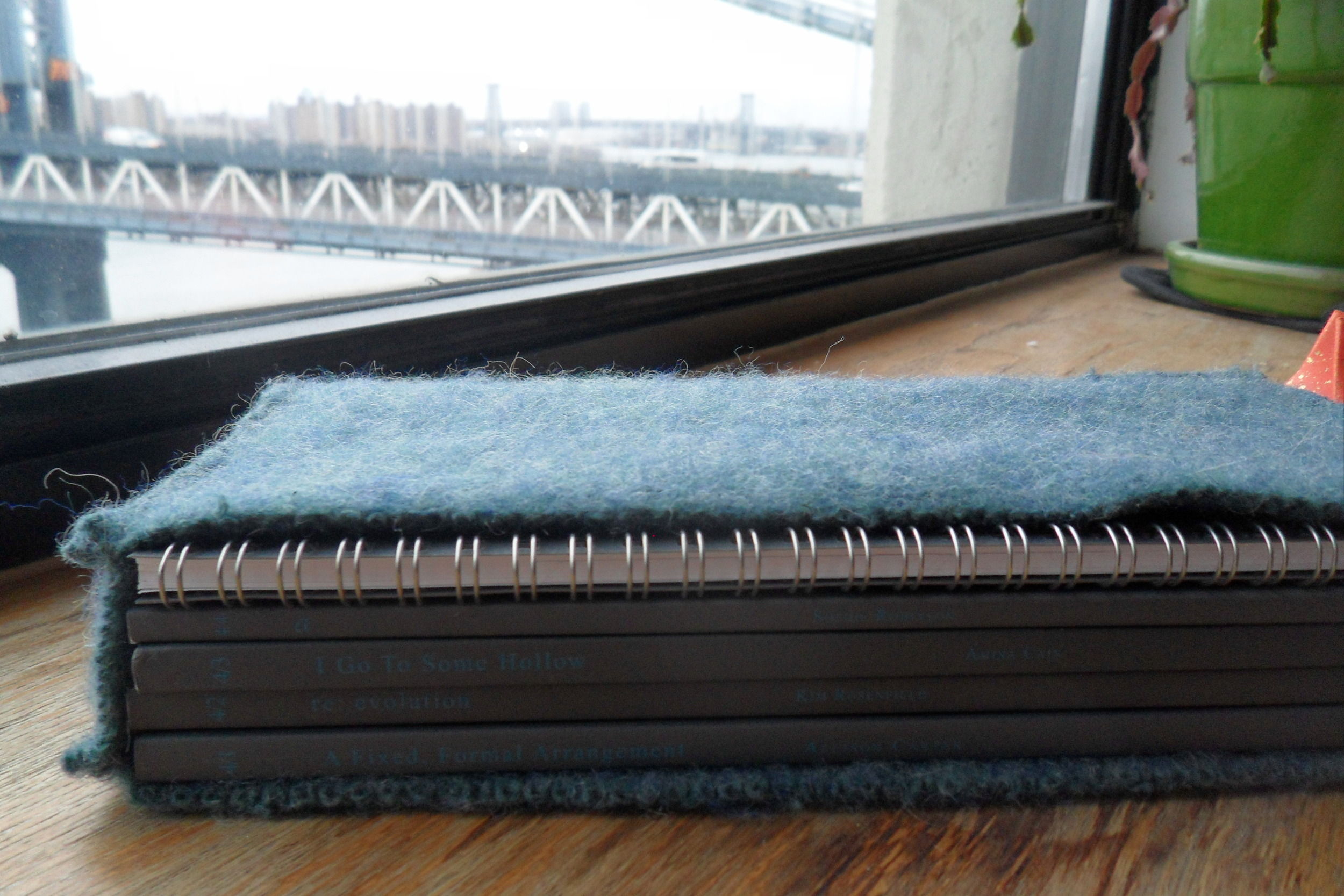 A one of a kind felted book sleeve for Les Figues Press's TrenchArt Series: TRACER