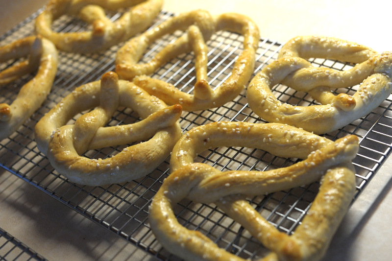 Once you have your pretzels all placed on your baking sheet, place them in a nice hot oven at 400 for about 12-15 minutes depending on how dark you like your pretzels to look. I like mine on the doughy side, so I tend to under bake them.  ;-)  Drizzle melted butter ALL over the pretzels after they have come out of the oven.   Viola. Diet starts Monday!
