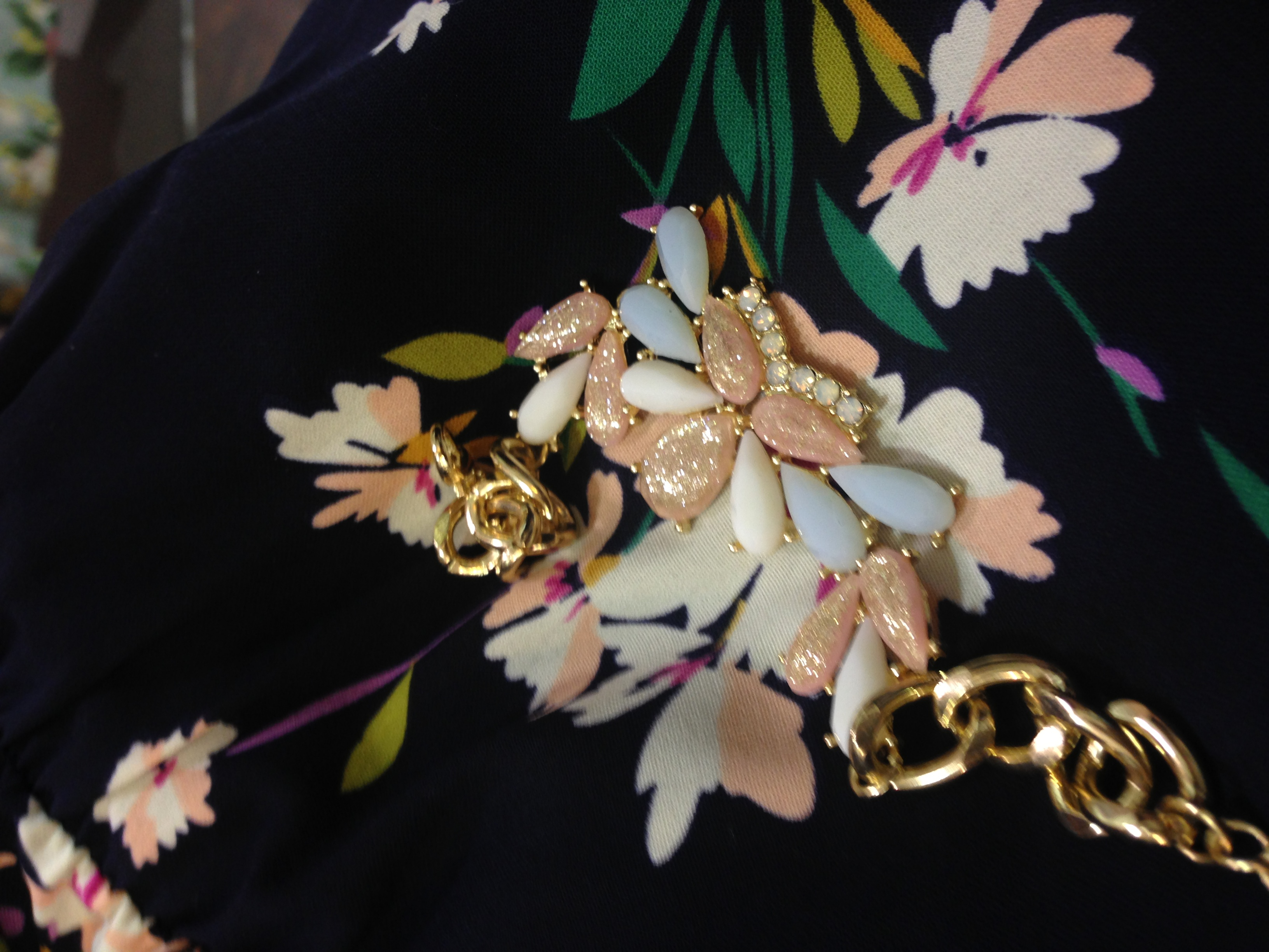 Floral dress with gold floral accessories...so spring  Photo: Emilie Lebel