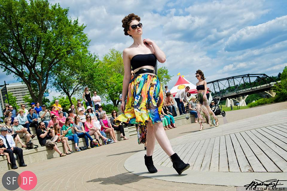 Models strut their stuff at last year's POSE at River Landing.