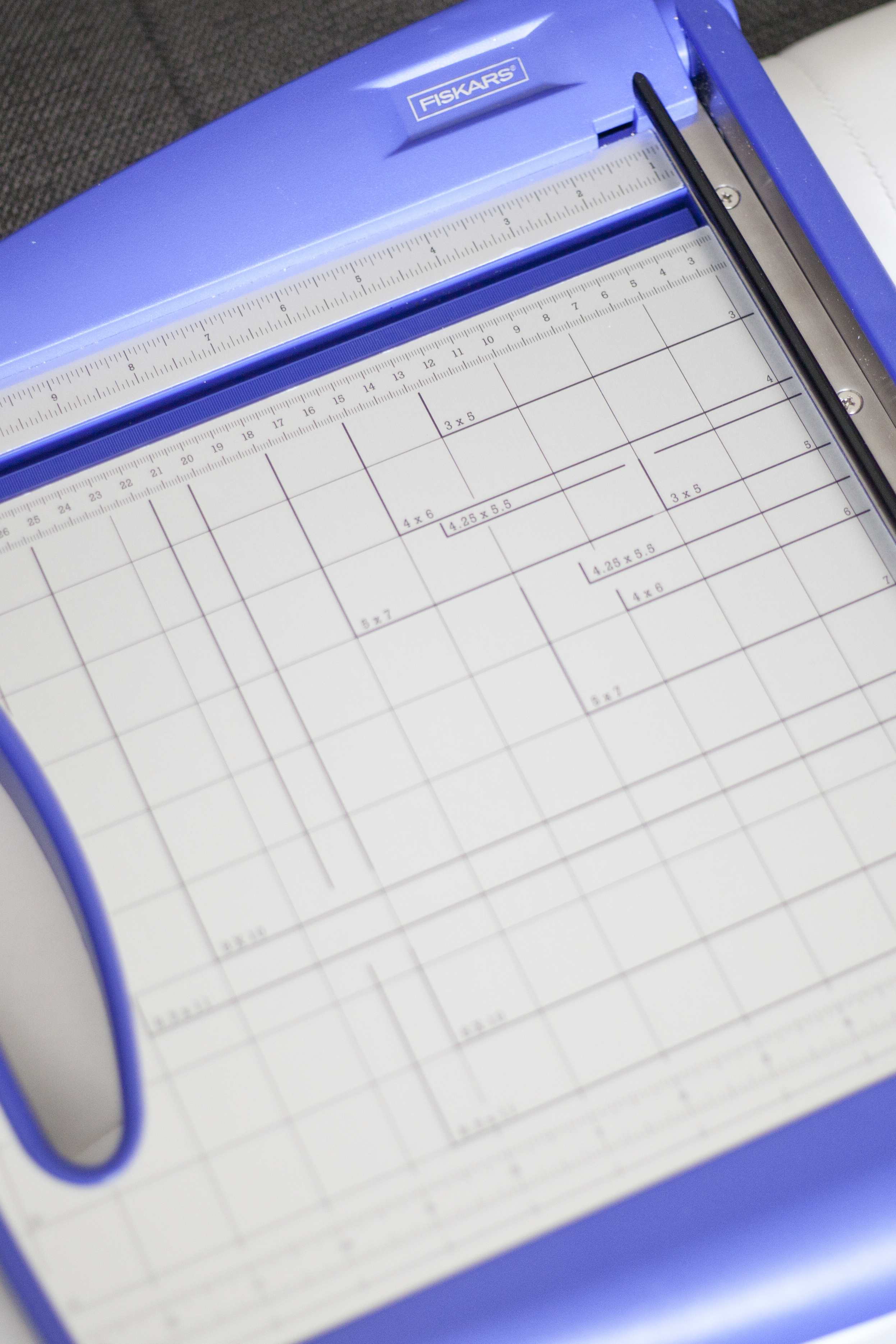 Paper cutter (you could also just use a ruler and scissors)