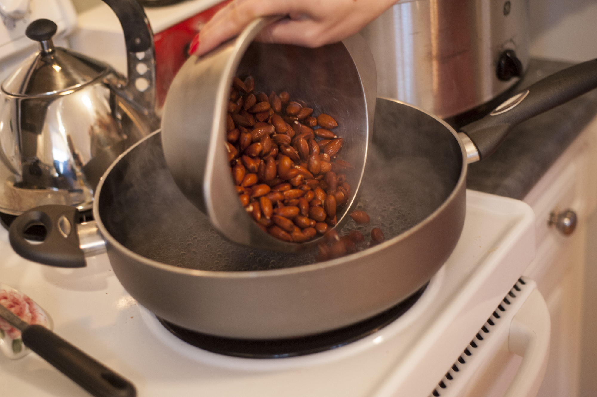 Blanch the almonds in boiling water for 60 seconds.