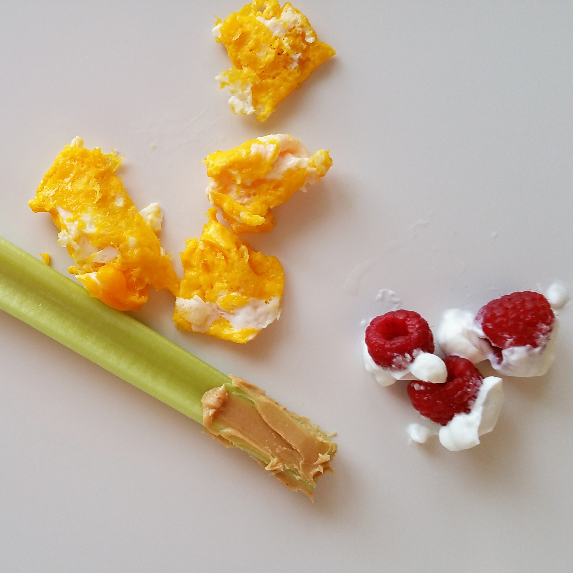 celery with peanut butter (avoid thecelery if your baby has a tooth), egg yolks, raspberries with Greek yogurt