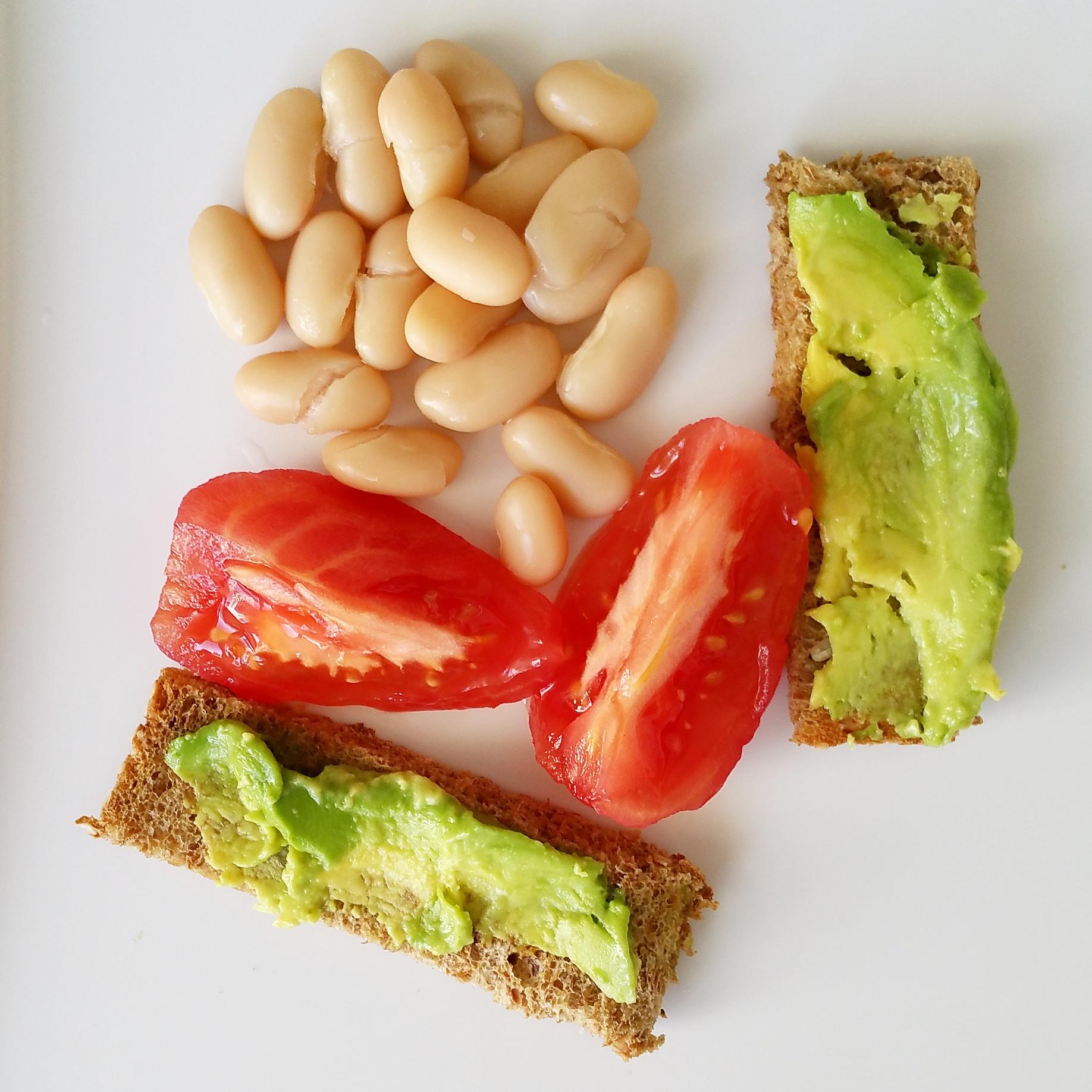 sprouted grain toast with avocado, tomato, white beans