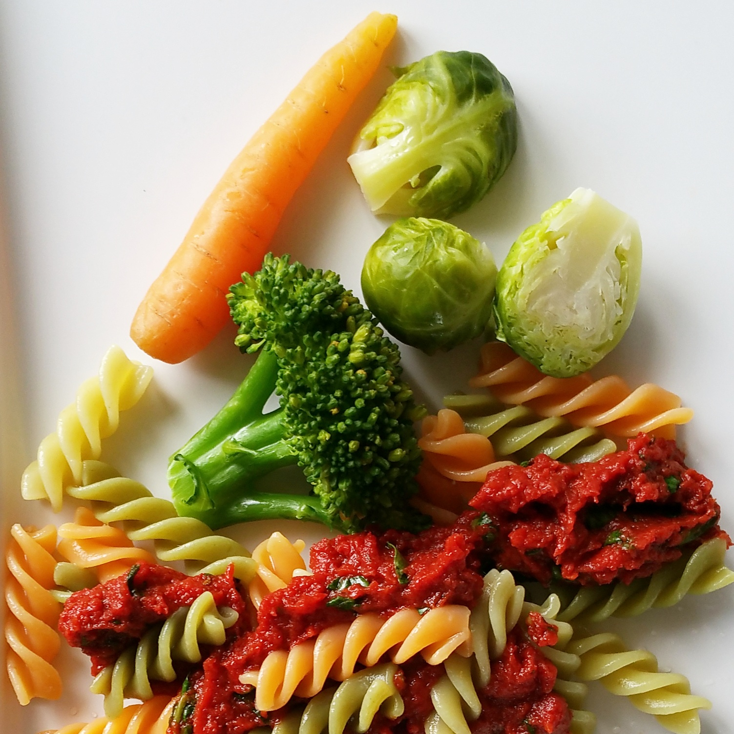 fusilli with tomato and spinach sauce, broccoli, brussel sprouts, carrot