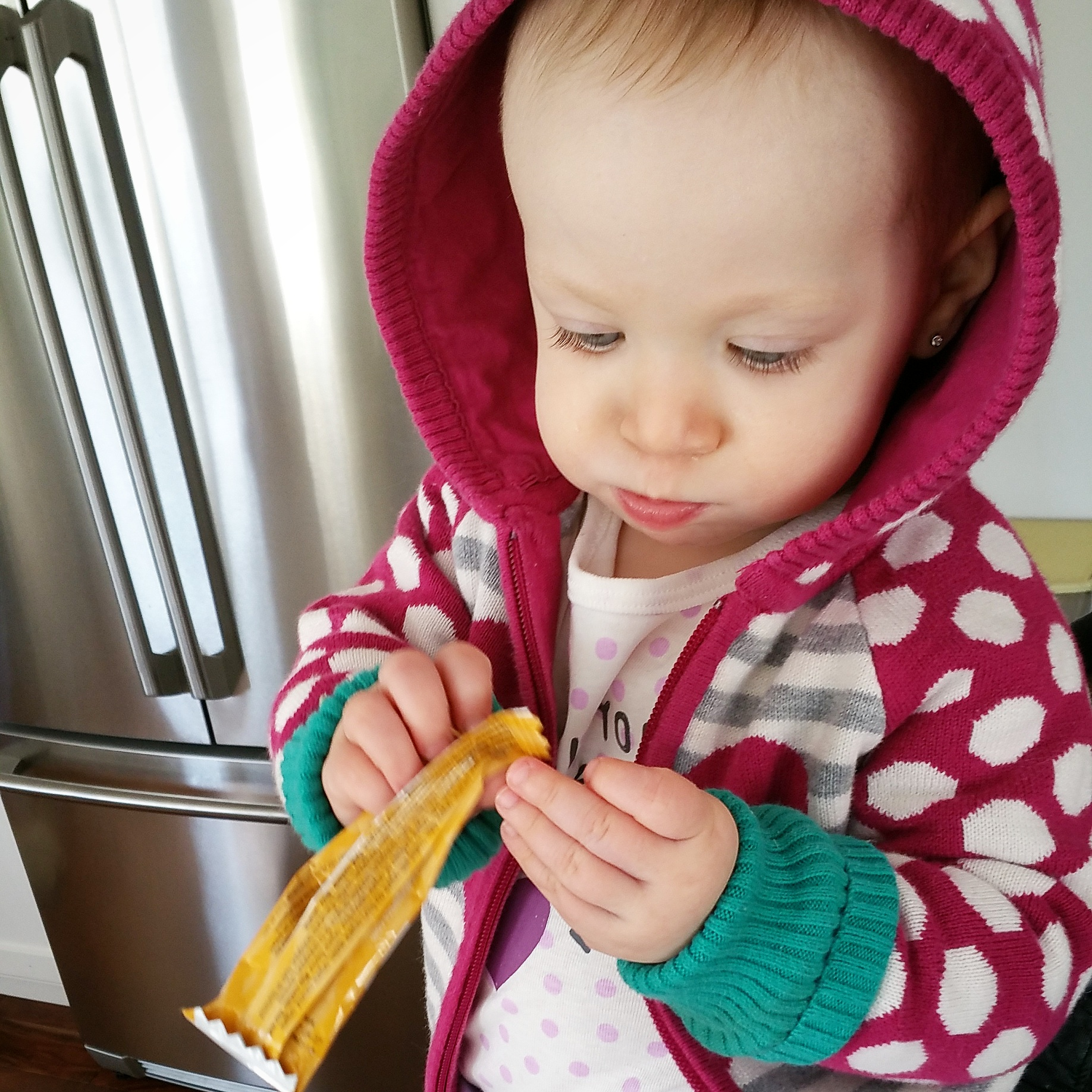 baby Petra eating Love Child organic bar