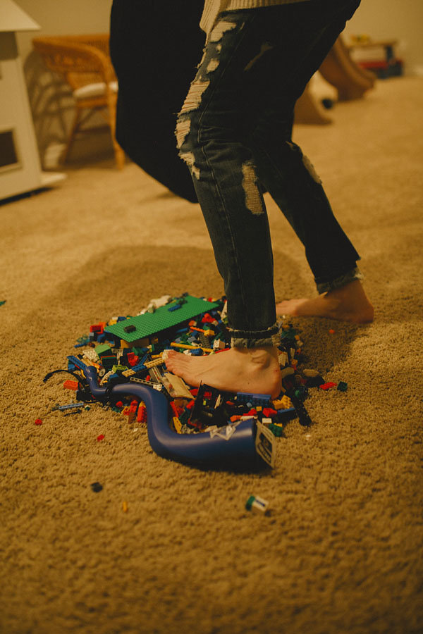 stepping on lego by DeMo