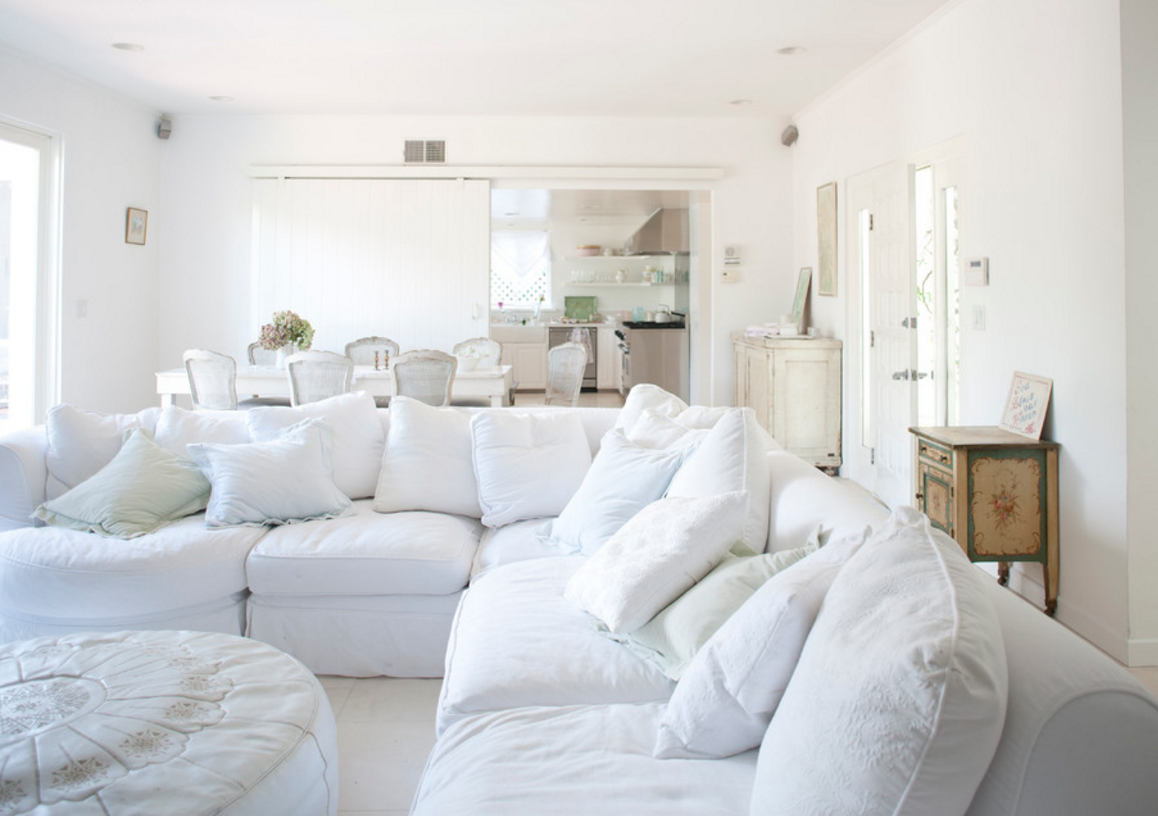 Try denim in different washes and colors! This bright white denim sectional is chic and serene. The oversized scale of the sectional does not overpower the room because of the fresh tone.
