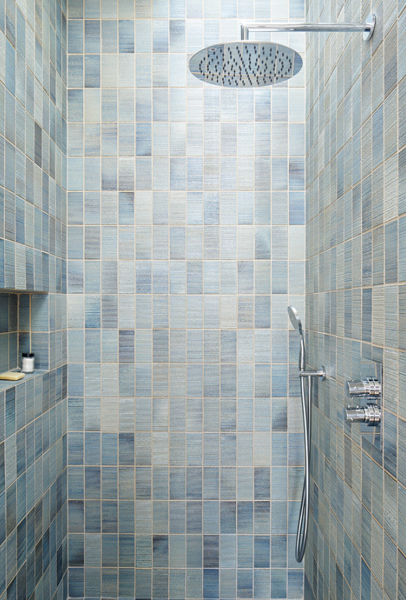 Consider denim in other areas like this custom shower clad in jean inspired tile. The colors are fun and uplifting and create a one-of a kind look!