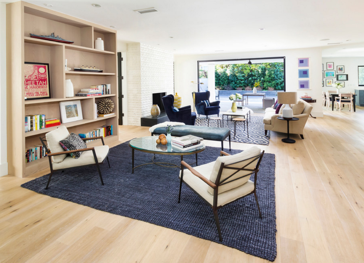 Do you have a large open space? Try the indigo tones as a division of space with a natural textured area rug. The rug anchors the space and creates cozy conversation areas. A denim bench was added for extra seating, but could easily be used on both sides of the space.