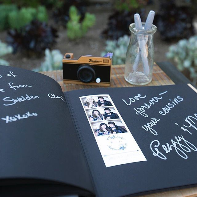 Guest Memory Book set-up....cute with a side of cuter. #detailsbaby #guestmemorybook #vwphotobooth #theboothbus