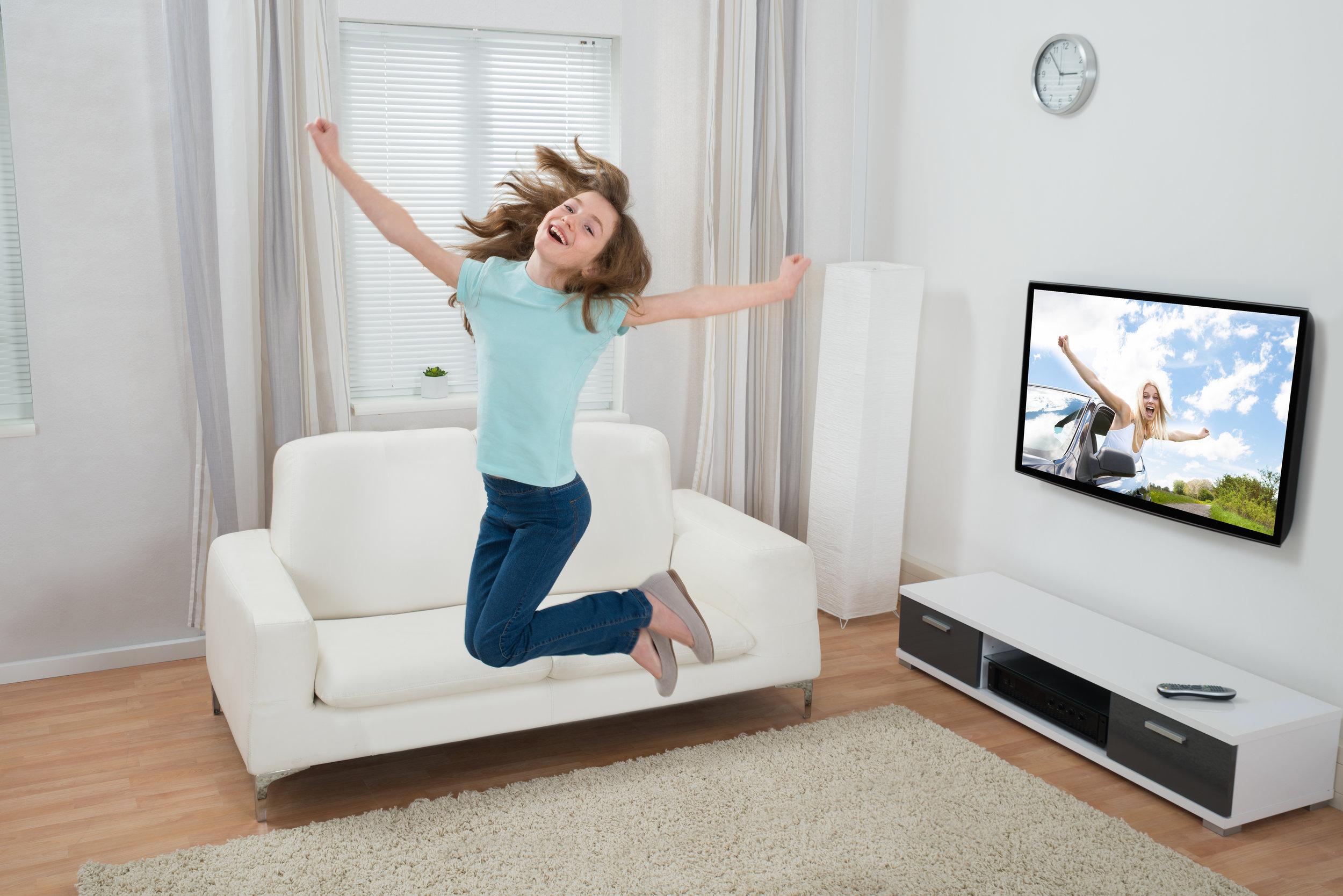Girl Jumping In Living Room