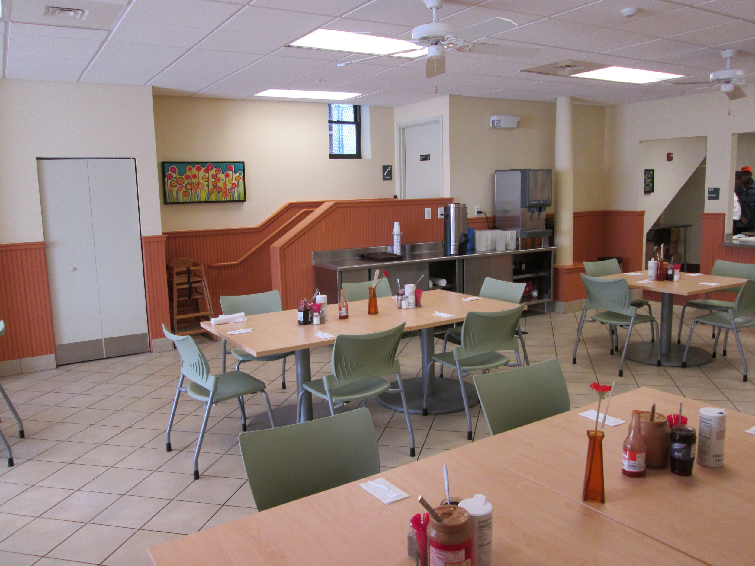 """Volunteers serve 300 meals daily at the """"Beans and Bread"""" building in Fells Point."""