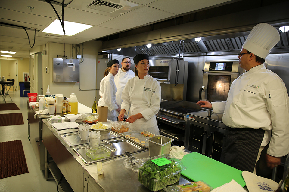 """York College Hospitality Management students use the fully renovated commercial kitchen in the building's Lower Level. The space is used as a teaching lab to learn the """"ins and outs"""" of managing a professional food service operation. (Photo courtesy of York College of Pennsylvania)"""
