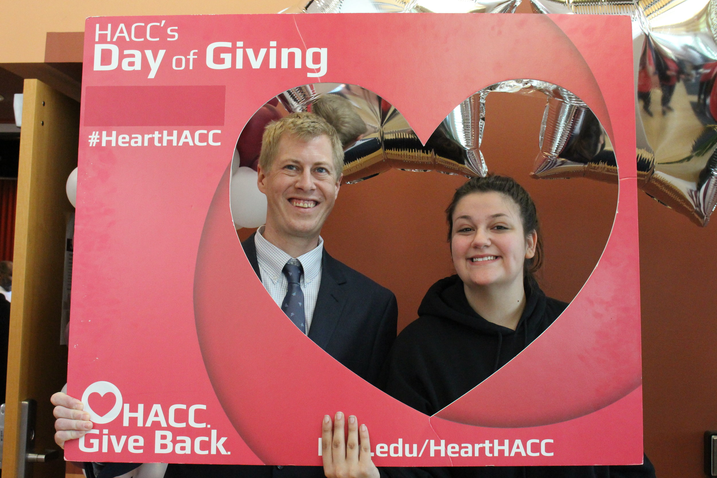 M&D Architect Ryan Shank, AIA, and this year's scholarship winner pose for a picture during HACC's annual Day of Giving this year.