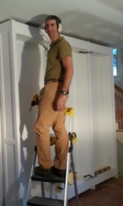 Here I am installing a library in Chevy Chase.  Almost don't even need the ladder and the level is just for show.