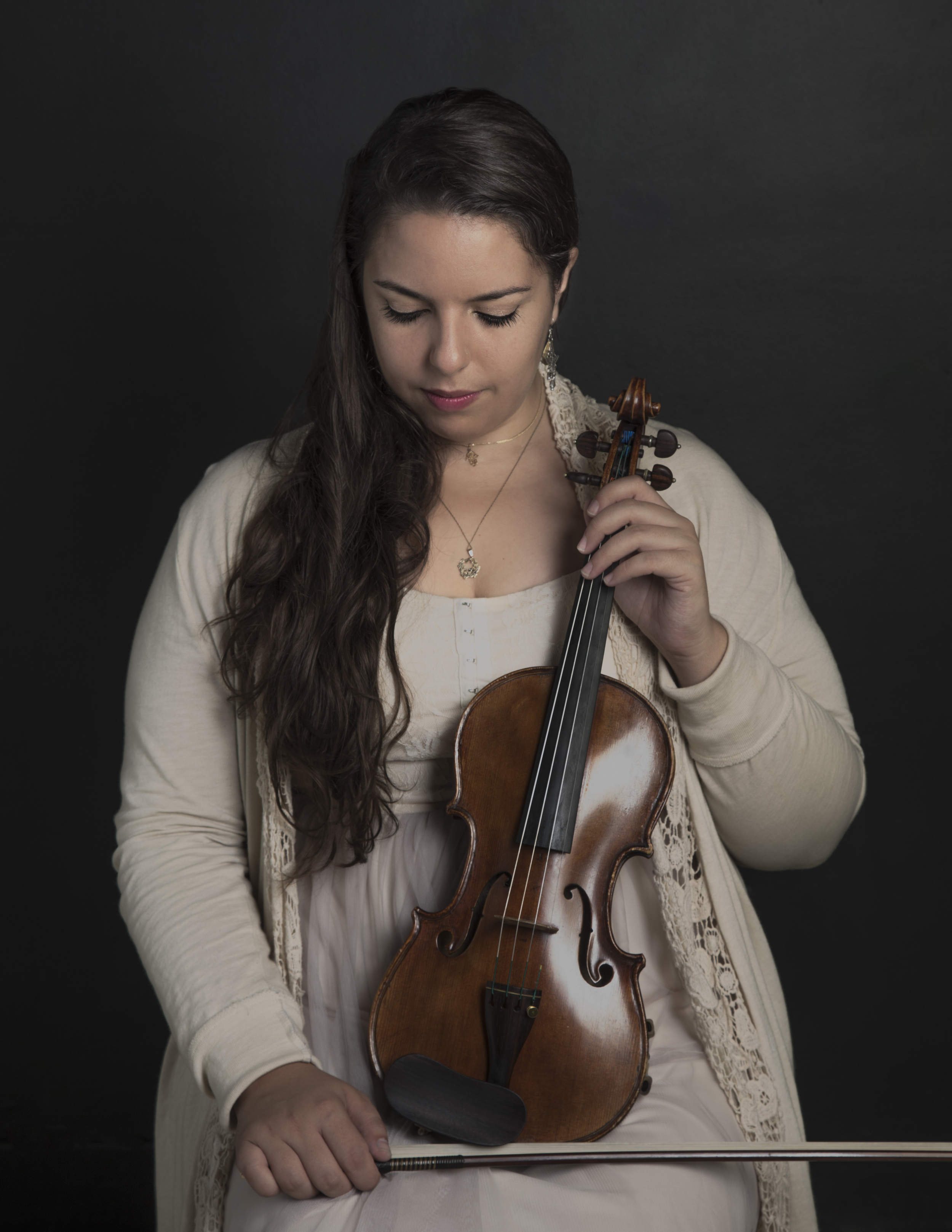 Lili Sarayrah   Violin    Lili completed her Bachelors of Music degree in violin performance at the Eastman School of Music in May 2014 and will spend the upcoming year focusing on a project that brings music to local refugees through the University of Rochester's Kauffman Entrepreneurial Year.