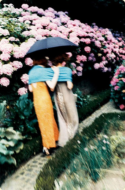 photo shoot styled by Grace Coddington, two art nouveau inspired models on a garden path