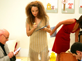 Sporting a luxuriously wild mane and translucent dress as a judge on the set of Bravo's Top Design, Via Design Public