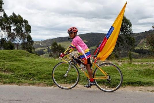A Nairo fan rides his bike near Combita. Note the home-painted tshirt