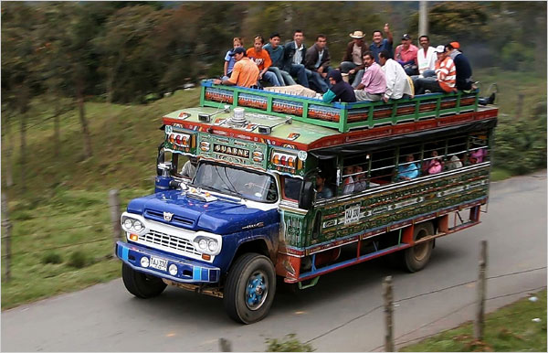 """A Colombian """"chiva"""", an inexpensive mode of transportation used in rural parts of the Colombian countryside."""