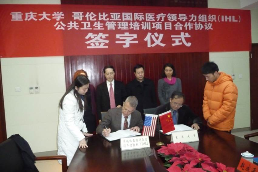Dr. David P Roye, Jr., signing an MOU with Chongqing University and Columbia University