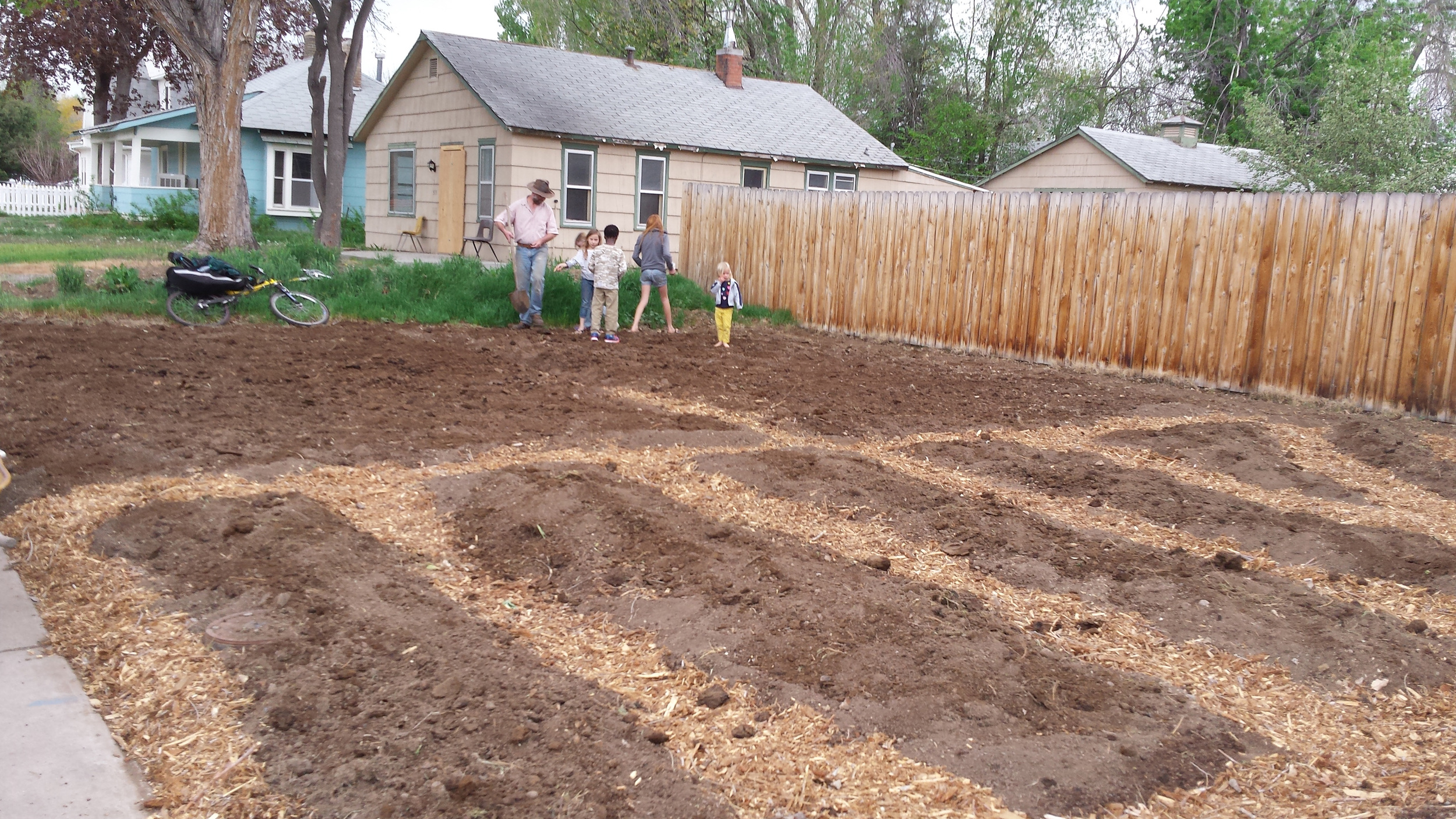 The kids helping Will plant our three sisters garden: corn, beans and squash