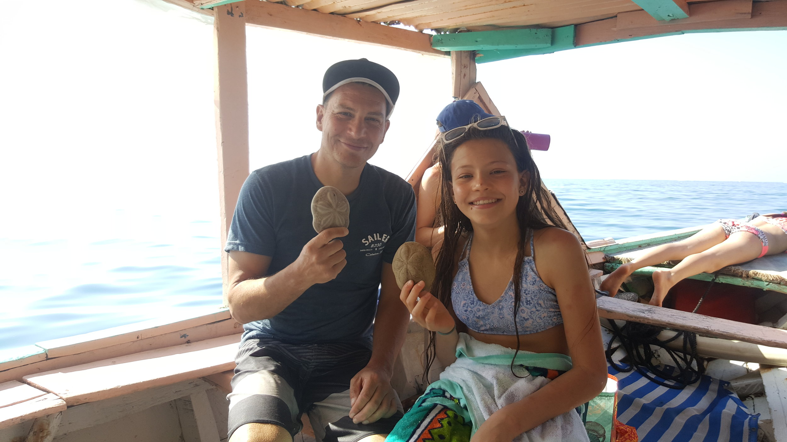 These two enjoyed diving for shells. It was Bella's first time snorkeling.