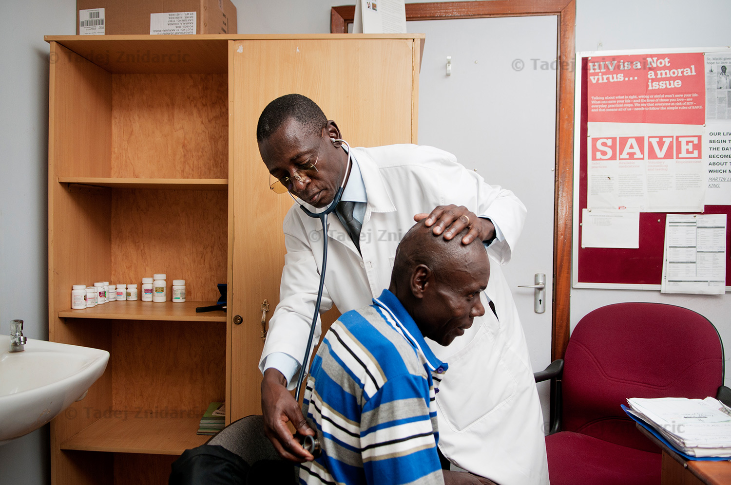 Dr. Watiti checks a patient at his office at Mildmay hospital.