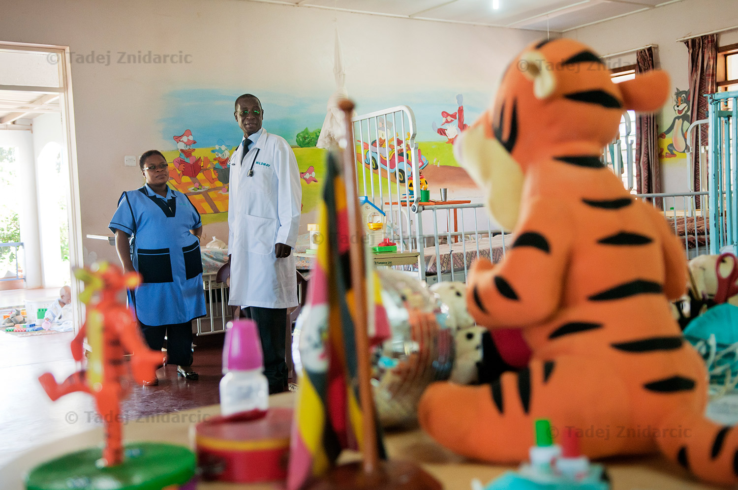 Dr. Stephen Watiti and nurse Rose Nannyonjo visit children's ward at Mildmay hospital.