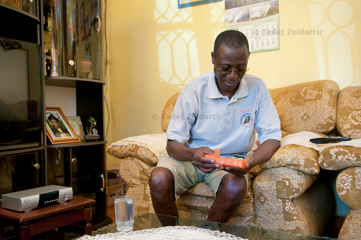 Dr. Stephen Watiti takes antiretroviral drugs at home.