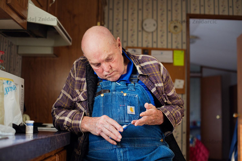 Walter measures his blood sugar at his home.