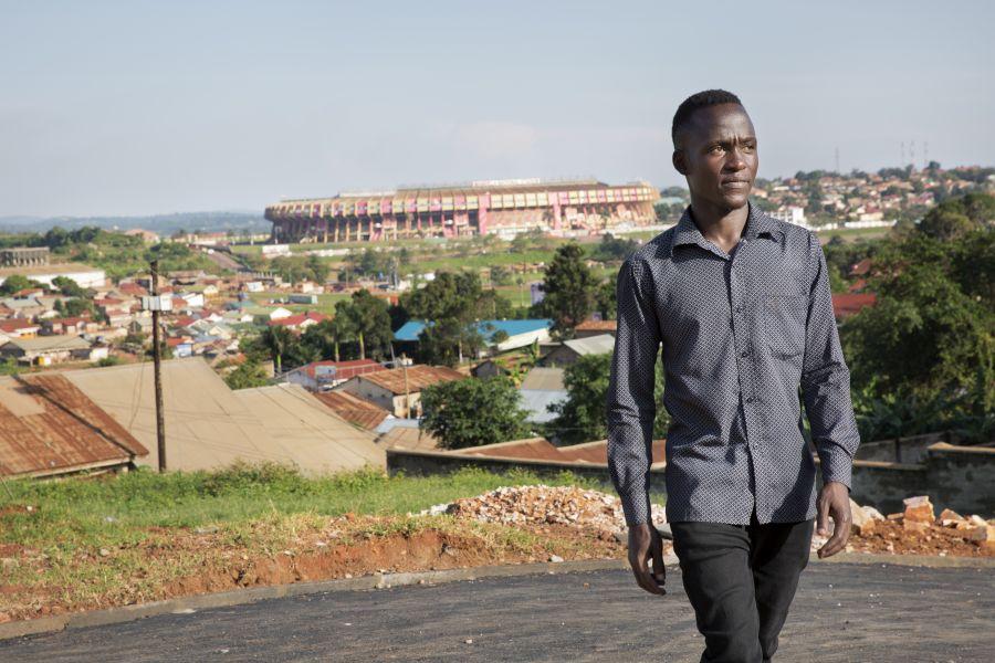 Peter walks in his neighbourhood that overlooks the stadium.