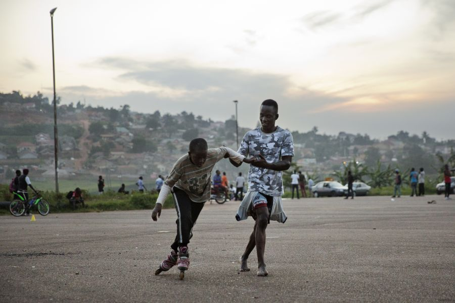 Peter helps a young skater at Mandela National Stadium.