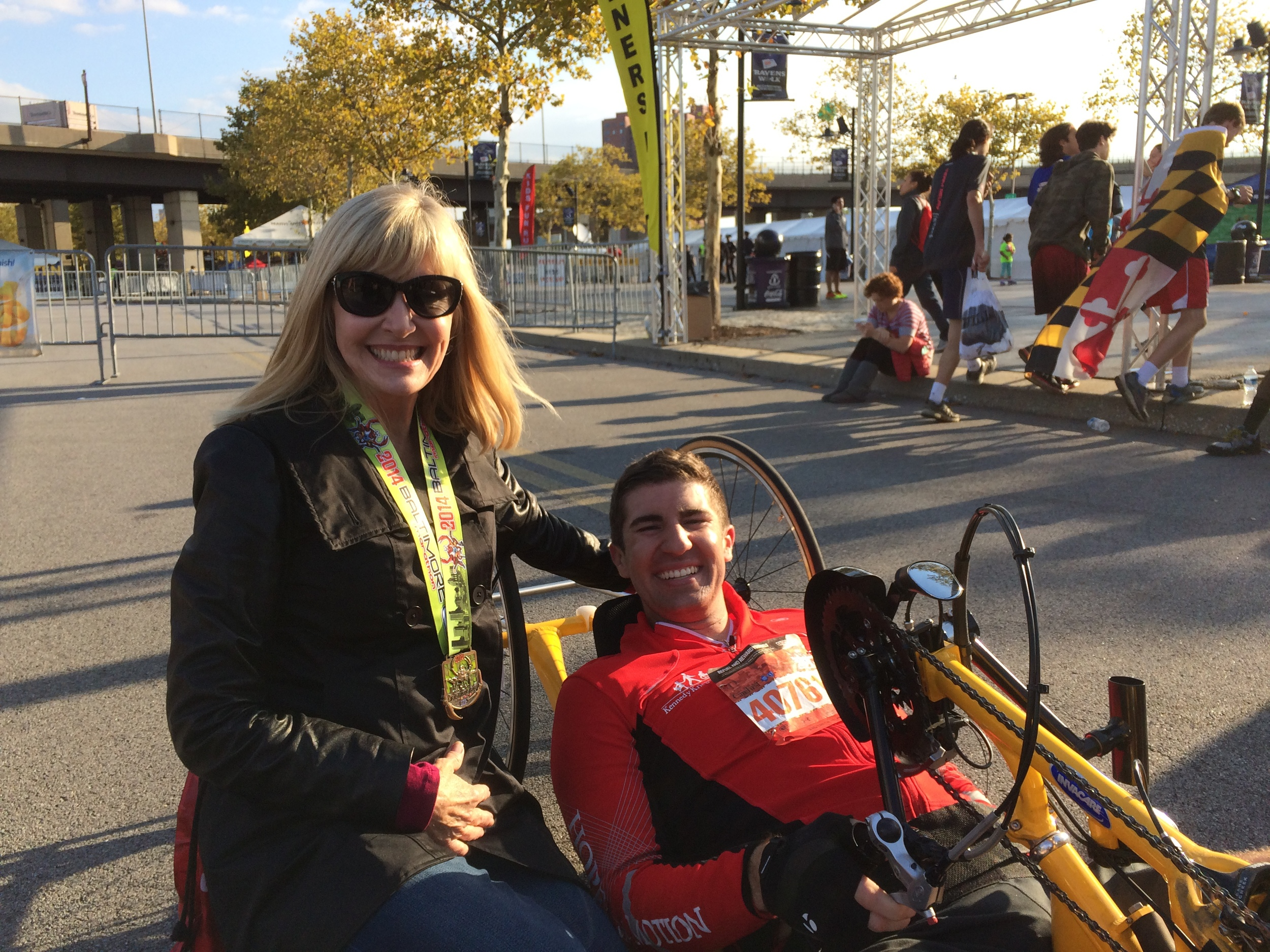 Mike and his mom at the Baltimore Running Festival, October 18, 2014, where he won 3rd place in the Handcycle division.