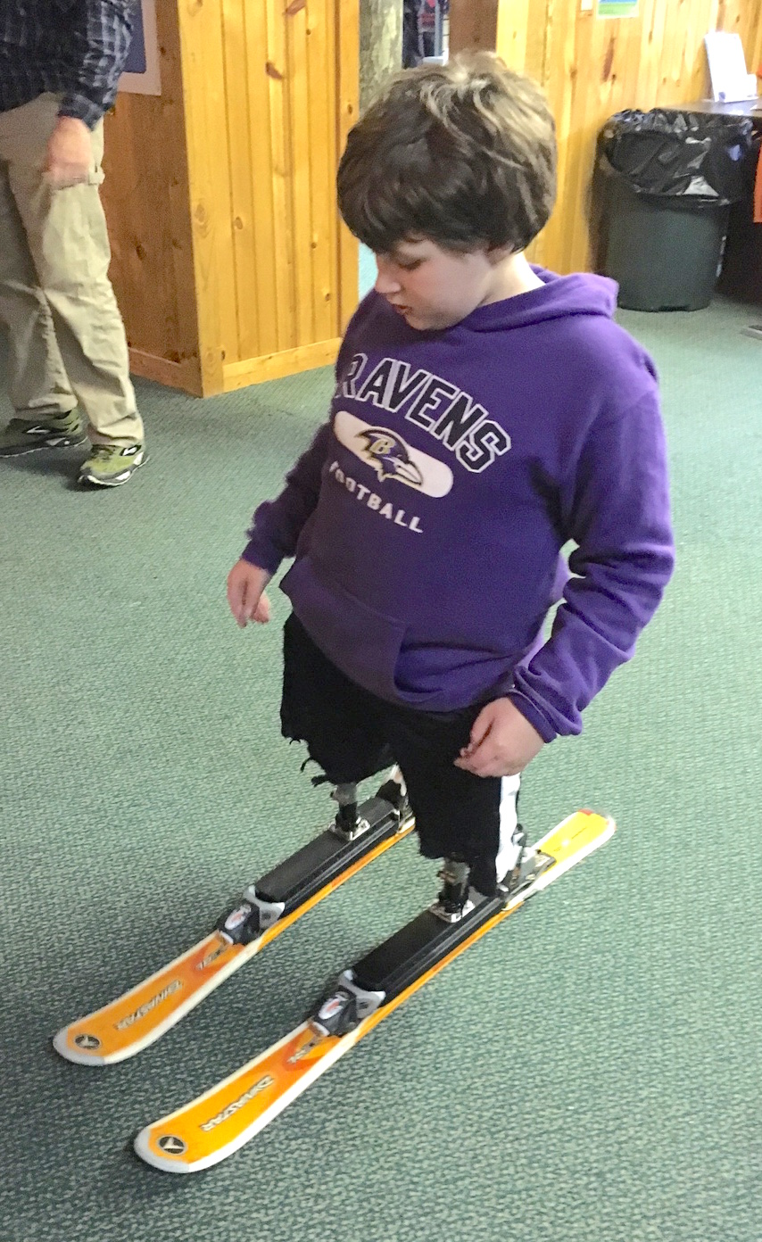Eric Flynn tries on his adaptive skis.