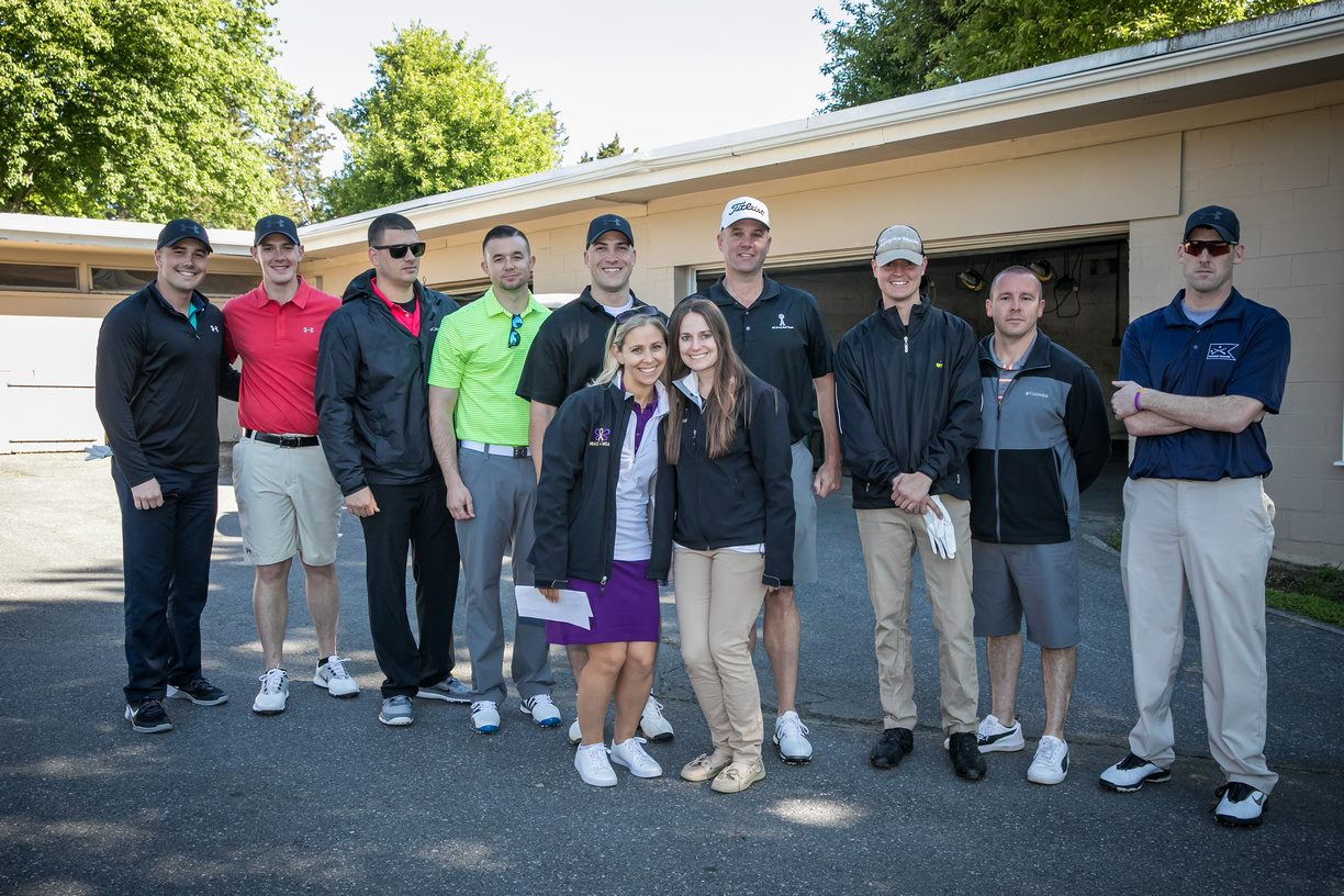 Erica and Sheryl with service members participating in golf outing.JPG